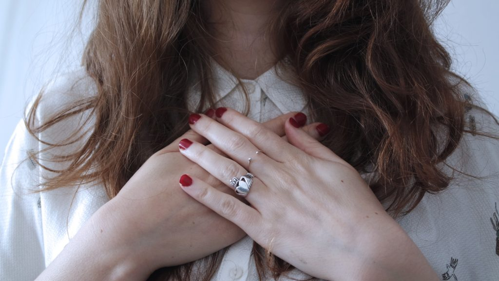 woman with hands on heart